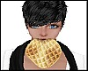 Boy eating waffle