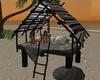 Lit beach tiki hut