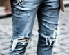 Ripped jean and boots