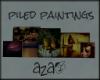 aza~ piled paintings