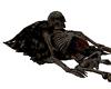 Skeleton on Pile of Skul