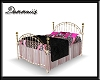 Pink and Black Brass Bed