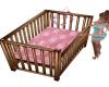 Brown pink baby crib