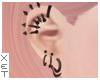 ✘ Piercings.
